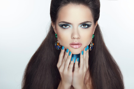 Fashion girl model. Manicured nails. Beautiful woman with Professional make-up and healthy hair styling. photo