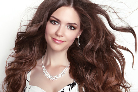 necklaces: Beauty fashion smiling girl model portrait. Long healthy Wavy hair. Professional makeup.