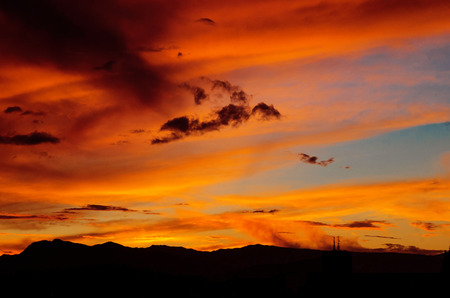 bliss: Colorful sunset behind hills, bliss Stock Photo