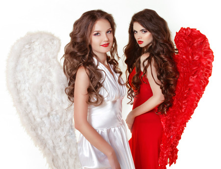 Attractive fashion beautiful angel girls with angels wings. Valentine Day Women. Isolated on white background. photo