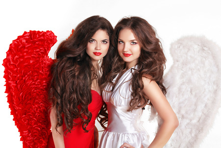 Beautiful fashion Valentines Girls Angels with angel's wings. Isolated on white background. Stock Photo