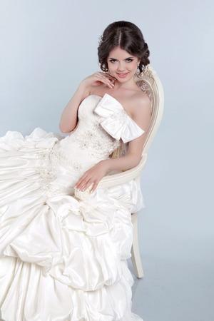 voluminous: Beautiful bride model woman wearing in wedding dress with voluminous skirt, studio photo