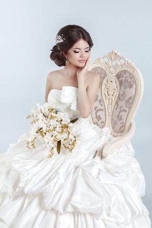 voluminous: Beautiful bride model girl wearing in wedding dress with voluminous skirt, studio photo