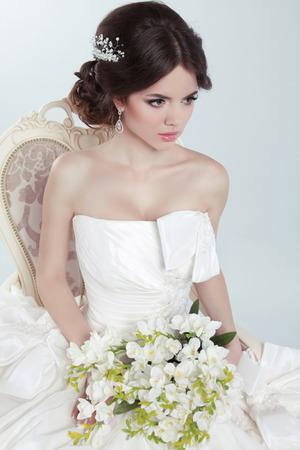 voluminous: Beauty Portrait of bride wearing in wedding dress with voluminous skirt, studio photo