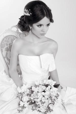 voluminous: Bride. Beautiful girl wearing in modern wedding dress. Fashion model. Black and white photo. Stock Photo