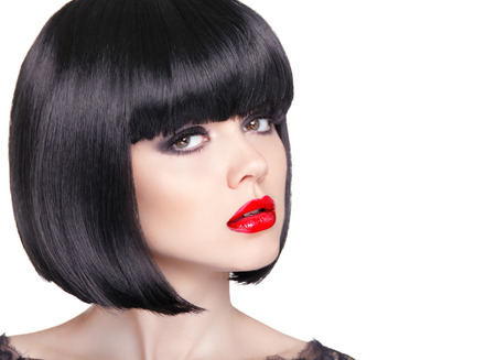 light hair: Fashion portrait of beautiful brunette woman with red lips and short bob black hair style isolated on white background, studio photo.