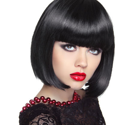 wig: Beautiful Woman With Black Short Hair. Haircut. Hairstyle. Fringe. Professional Makeup. Lady isolated on white background.