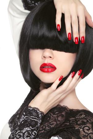 manicure woman: Fashion model. Long Black Fringe. Red sexy lips. Bob Hairstyle. Polish manicured nails. Haircut. Trendy woman portrait.