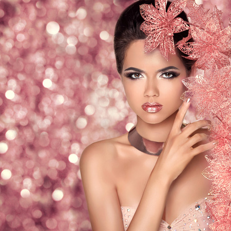 christmas perfume: Makeup. Glamour Fashion Portrait of Beautiful Attractive Girl With Flowers. Beauty Model Woman Face isolated holiday bokeh lights background. Stock Photo