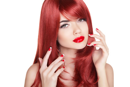 Long shine red hair. Attractive girl with manicure nails and beauty makeup isolated on white background.