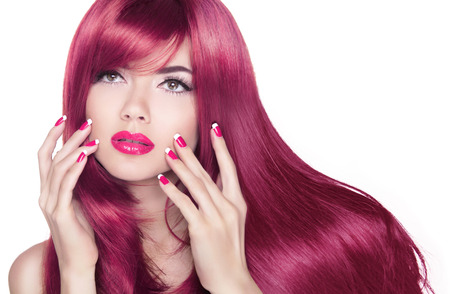 glamour hair: Long wavy shine hair. Attractive girl with manicure nails and beauty makeup isolated on white background.