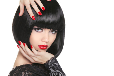 Manicured nails. Beauty girl portrait. Red lips. Back short bob hair. Hairstyle. Professional makeup.