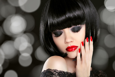 eye red: Makeup. Manicured nails. Beauty girl portrait. Back short bob hair. Hairstyle. Smokey eyes.