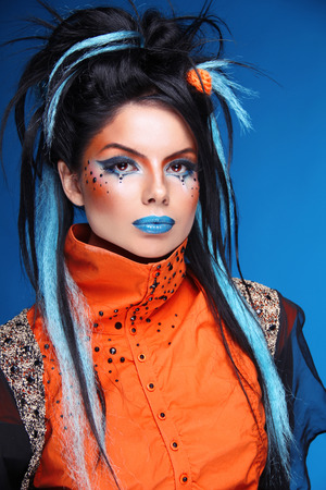 crazy hair: Makeup. Rock hairstyle. Portrait of young beautiful punk model with blue lips, black hair.