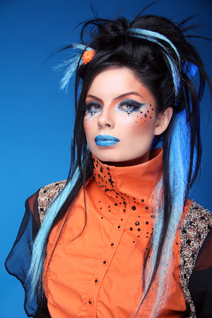 punk rock: Makeup. Rock hairstyle. Portrait of young beautiful punk model with blue lips, black hair.