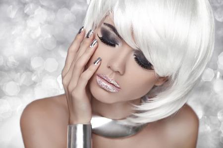 eyeshadows: Beauty Portrait Woman over bokeh Grey Background. Stock Photo