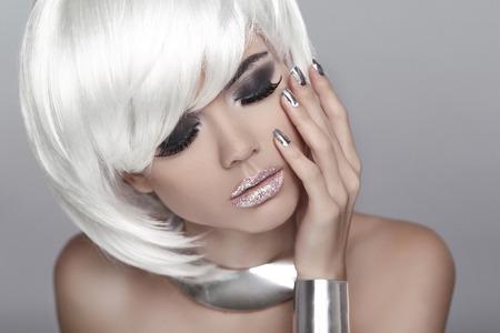 silver jewelry:  Fashion Blond Girl.  Stock Photo