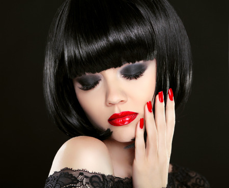 glam: Eye makeup. Fashion Beauty Brunette Woman Portrait. Red lips and manicured nails. Bob hairstyle.