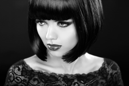woman hairstyle: Retro woman portrait. Fashion model girl face. Bob hairstyle. Black and white photo.