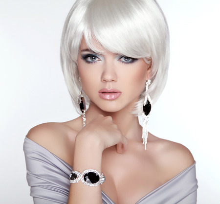 a bracelet: Glamour Fashion Blond Woman Portrait. Makeup. White short bob hairstyle. Expensive Jewelry.