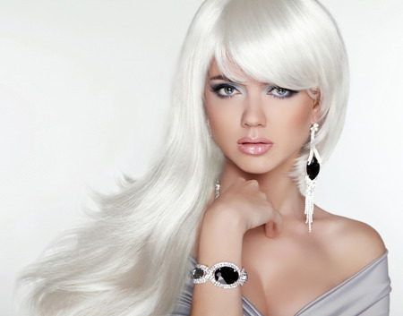 jewelry: Beauty attractive blond portrait. White Long hair. Fashion girl model posing with Expensive Jewelry.