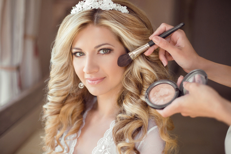 makeup: make up rouge. Healthy hair. beautiful smiling bride wedding portrait. Stylish makes makeup Young woman with long curly hair style. Stock Photo