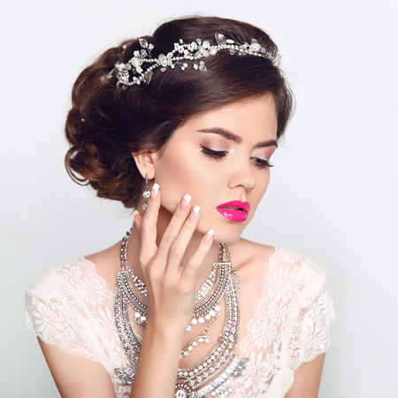 Beauty Fashion Model Girl with wedding elegant hairstyle. Beautiful bride woman with precious jewels, manicured nails. Makeup. Elegant style.