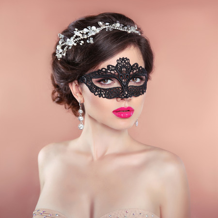 hairstyle: Elegant hairstyle. Beauty fashion Girl in black veil mask. Masquerade. Makeup. Hairstyle. Jewelry.