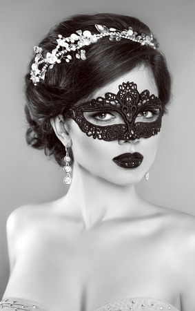beautiful background: Beautiful Girl in black veil mask. Masquerade. Makeup. Hairstyle. Jewelry. Black and white portrait.