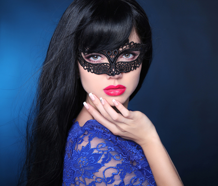 Healthy elegant hairstyle. Beautiful brunette girl model. Manicured nails. Beauty glamour woman wearing in venetian masquerade carnival mask.