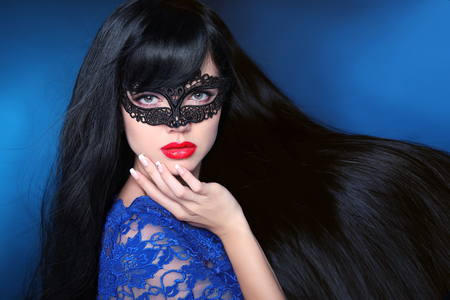Beautiful Healthy Hair. Beauty woman in mask with luxurious long hairstyle. Red lips. Attractive girl with long smooth shiny straight hair over dark blue background. Haircare cosmetics.