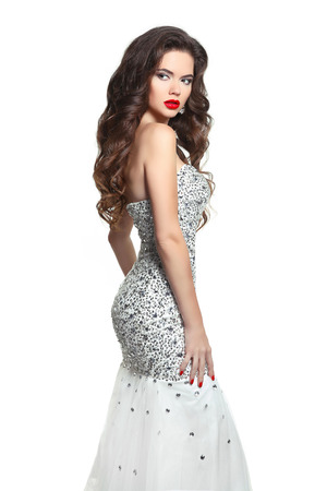 Beauty Bride woman in wedding dress. Long hair, makeup. Brunette posing in Shiny Beaded Sequins Mermaid formal party gown isolated on white background.