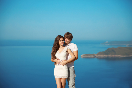 Romantic affectionate young couple in love on vacation over sea and blue sky. Wedding Travel.  Exotic Island.