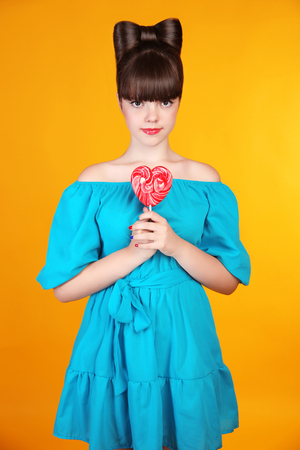 lolli: Heart Lollypop. Beautiful teen girl with colourful  lolli pop.