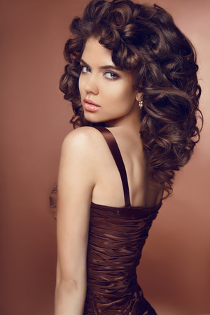 Hairstyle. Beautiful Woman With Makeup And Healthy Curly Hair ...