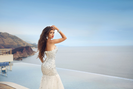 beaded: Beautiful bride girl in beaded wedding dress. Summer holiday fashion concept.