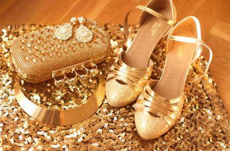 jewlery: Golden. Womens clothes and accessories. Fashion Shoes. Luxury jewelry. Expensive pendant close-up background. Shiny Crystal Precious Gem Jewels