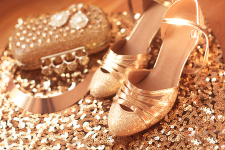 jewel: Golden. Shoes. Womens accessories. Luxury fashion  jewelry. Expensive pendant close-up background. Shiny Crystal Precious Gem Jewels