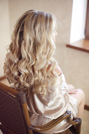 hair back: Healthy hair. Curly long hairstyle. Back view of Blond hairs. hair styling. Wedding day. Bride.