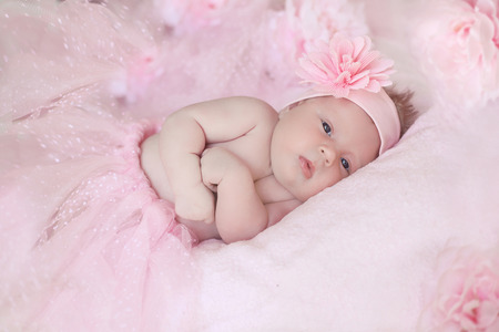 adorable child: Portrait of adorable baby girl over pink, infant child.