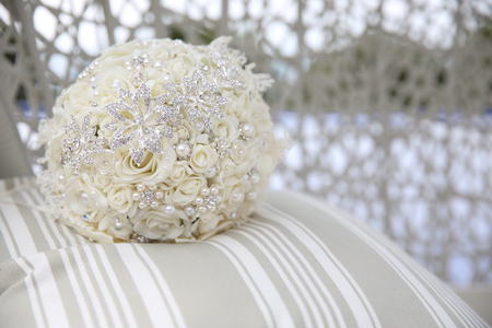 close up of wedding bouquet with brooches Stock Photo