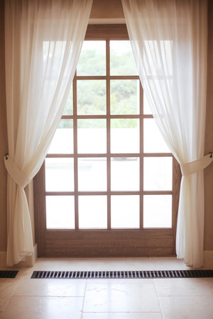 wood panel: wooden window frame with white curtain