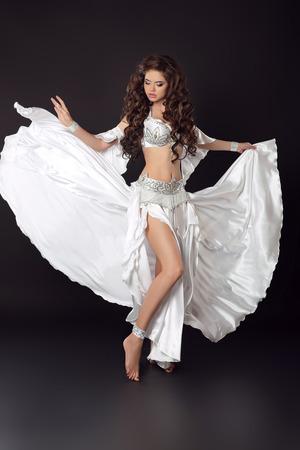 bailarinas arabes: Dancing woman belly dancer, bellydance ballerina, arabian beauty female isolated on black studio background.