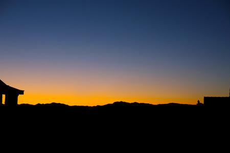 faintly visible: Sunset sky background. Sunrise mountains. Stock Photo