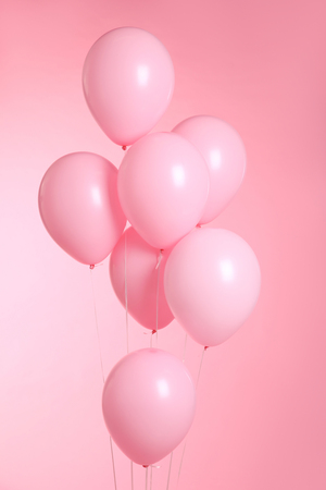 closeup of balloons isolated on pink background Banco de Imagens