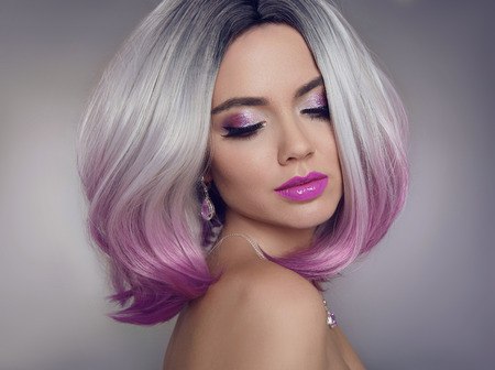 Colored Ombre hair extensions. Beauty Model Girl blonde with short bob purple hairstyle isolated on gray background. Closeup woman portrait. Standard-Bild - 93701897