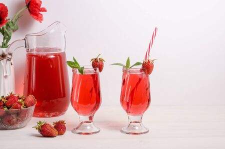 Summer cooling drink with strawberries and ice on a white background with copy space. Horizontal photo
