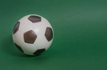 Soccer ball on a green background with copy space. Announcement of football matches.