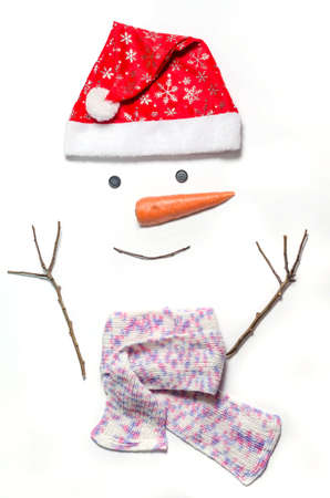 Snowmans face on a white background. A set of items for making a snowman - a red hat, a scarf, carrots, eyes - buttons, branches. how to make a snowman. Stock fotó