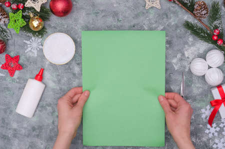 Christmas craft - paper tree, step by step instructions. Step 2- take a green A4 sheet of paper